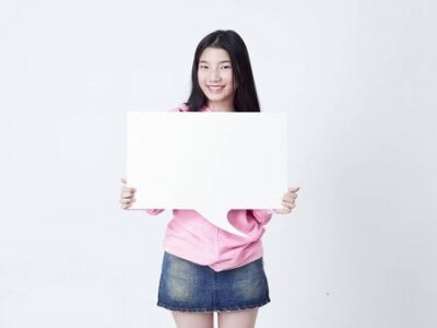 Plakat Portrait of teenage girl showing placard empty isolated on white background.