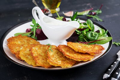 Potato fritters/draniki/pancakes served with sour cream. European cuisine. Kosher eating. Vegan food.