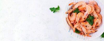 Prawns on bowl. Shrimps, prawns. Whole boiled shrimp. Seafood. Top view, banner, copy space
