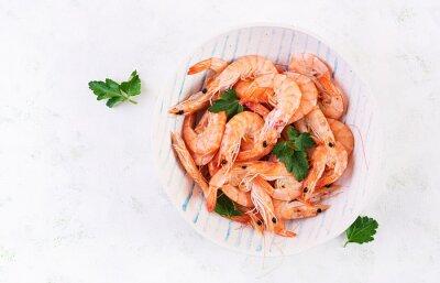 Prawns on bowl. Shrimps, prawns. Whole boiled shrimp. Seafood. Top view, flat lay, copy space