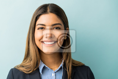 Plakat Pretty Hispanic Businesswoman Smiling In Studio