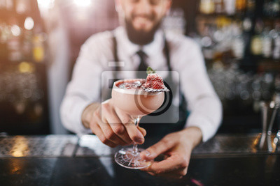 Plakat Professional bartender is making cocktail at night club