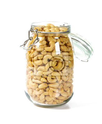 Plakat raw cashew in a glass jar isolated on white