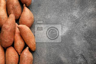 Plakat Raw sweet potato on grunge background