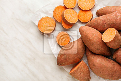 Plakat Raw sweet potato on light background