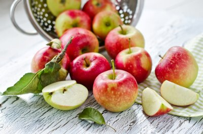 Plakat Red fresh apples from garden with leaves on wooden background