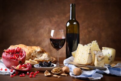 Plakat Red wine, cheese, walnuts, olives, pomegranate and bread
