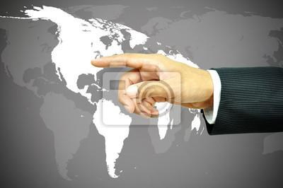 Plakat Ręka dotyka mapy świata