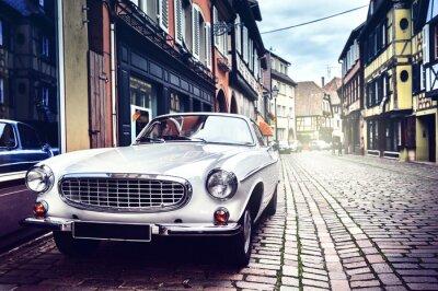 Plakat Retro car in old city street