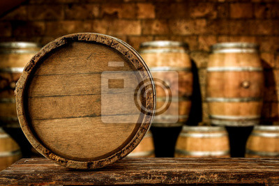 Retro old barrel on wooden table and free space for your decoration.