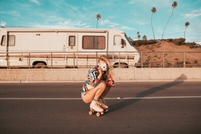Plakat retro style skater girl with a camper van in the background. california lifestyle
