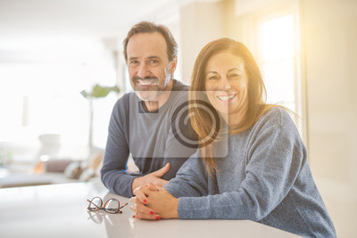 Plakat Romantic middle age couple sitting together at home