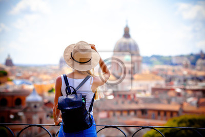 Plakat Rome Europe Italia travel summer tourism holiday vacation background -young smiling girl with mobile phone camera and map in hand standing on the hill looking on the cathedral Vatican