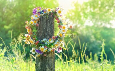 Plakat rustic wildflowers wreath on sunny meadow. Summer Solstice Day, Midsummer concept. floral traditional decor. pagan witch traditions, wiccan symbol and rituals