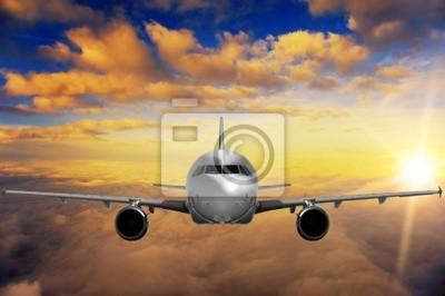 Plakat Samolot na zachód słońca nieba