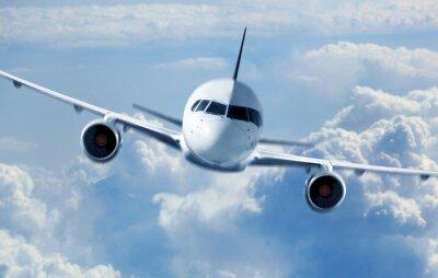 Plakat Samolot pasażerski latający w chmurach