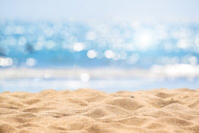 Plakat Seascape abstract beach background. blur bokeh light of calm sea and sky. Focus on sand foreground.