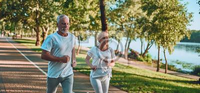 Plakat Senior couple doing sport outdoors
