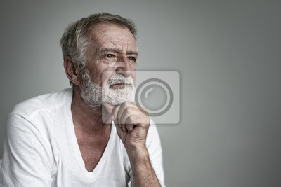 Plakat senior man thinking or try to remember alone closeup