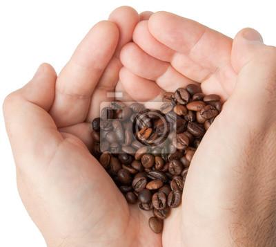 Serce z ziaren kawy w ręce