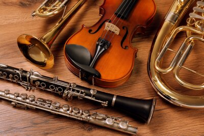 Plakat Set of different musical instruments on wooden background, closeup