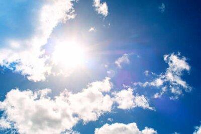 Plakat Shining sun at clear blue sky
