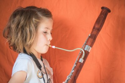 Plakat Side View Portrait Of A Girl Playing Bassoon