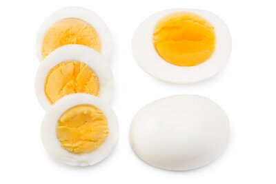 Plakat Single whole boiled egg with halved egg isolated on a white background. Top view