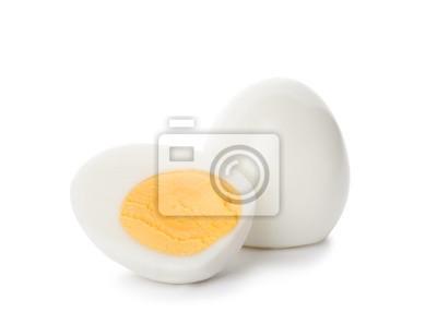 Plakat Sliced and whole hard boiled eggs on white background