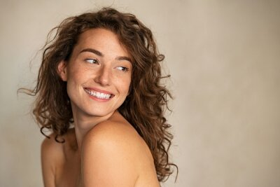 Plakat Smiling beauty woman with freckles looking away