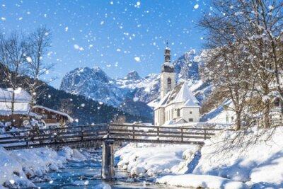 Plakat Snowfall in Ramsau, the parish church Saint Sebastian in winter, Ramsau, Berchtesgaden, Bavaria, Germany