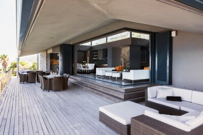 Plakat Sofa, tables and chairs on modern balcony