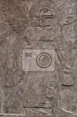 Plakat Starożytna asyryjski relief gliny przedstawiające orła boga o twarzy
