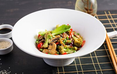 Stir fry vegetables with mushrooms, paprika, red onions and broccoli. Healthy food. Asian cuisine.