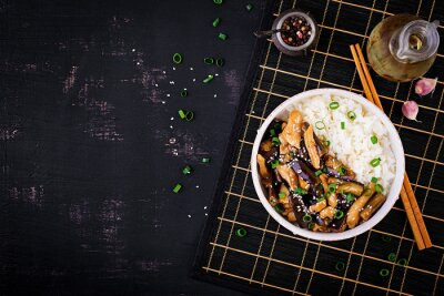 Stir fry with chicken, eggplant and boiled rice - Chinese food. Top view