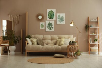 Plakat Stylish living room interior with comfortable sofa and beautiful pictures on wall