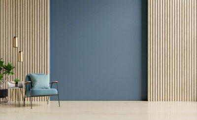 Plakat Stylish Modern wooden living room has an armchair on empty dark blue wall background.