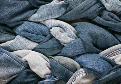 stylowe tło tkaniny wielu warkocze sznurowane w niebieskie dżinsy