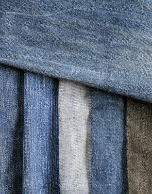 stylowy teksturowanej tle ramki z pasków denim w różnych odcieniach