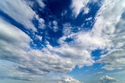Plakat Summer Blue Sky and white cloud white background. Beautiful clear cloudy in sunlight calm season. Panoramic vivid cyan cloudscape in nature environment. Outdoor horizon skyline with spring sunshine.