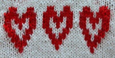 świąteczna dzianiny tło z białych i czerwonych serc