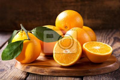 Plakat świeże pomarańczowe owoce z liśćmi