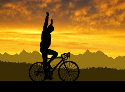 Plakat Sylwetka rowerzysty na rowerze drogowego na zachodzie słońca