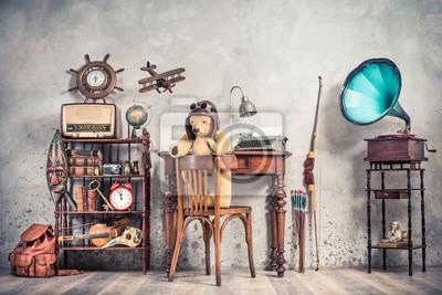 Plakat Teddy Bear toy on chair, typewriter, vintage gramophone, old books, radio, globe, binoculars, carnival mask, camera, fiddle on shelf, steering wheel, plane, travel backpack, bow. Retro style photo