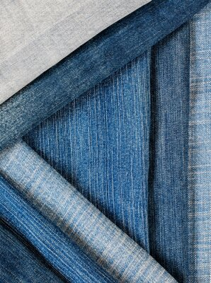 textile fabric pants background many different pants jeans of different shades blue stacked layers