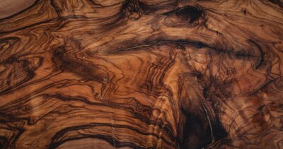 Plakat texture of dark brown olive wood plank. background of wooden surface
