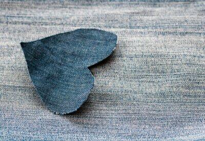 textured heart background of denim lies on blue fabric