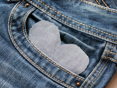 textured heart fabric background peeks out from pocket blue pants jeans