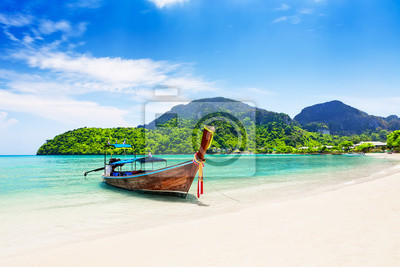 Plakat Thai traditional wooden longtail boat and beautiful sand beach.