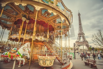 Plakat The retro carousel and the Eiffel Tower with a retro effect. Trend photography style. Soft and pastel color
